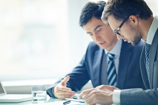 Businessmen discussing work during a meeting at office